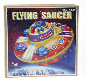 classic tin toy space flying saucer with
