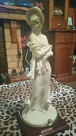vintage figurine of lady with shawl by b