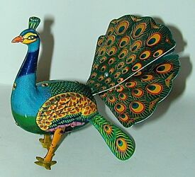 the proud peacock lithographed tin wind up