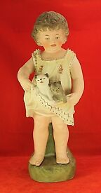 11 standing piano baby holding cats in dress