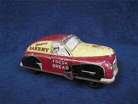 vintage modern bakery wind up delivery sedan
