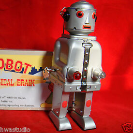 ms645 vintage light tin toy wind up action