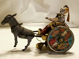 antique balky mule clown tin litho wind up