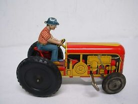 vintage made in usa tin wind up farmer on