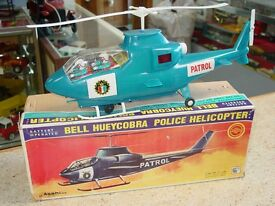 vintage bell huey cobra police helicopter in