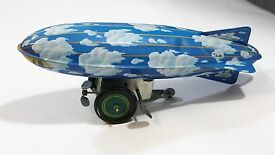 original vintage windup tin toy sky blue