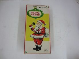 vintage wind up mechanical santa claus toy