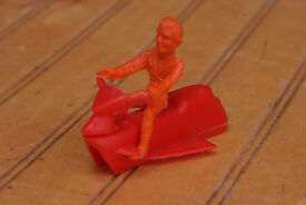 vintage 1960 s figure with a rocket car