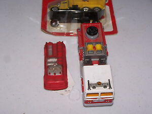 three toy trucks 1 majorette 1 auburn 1 mib