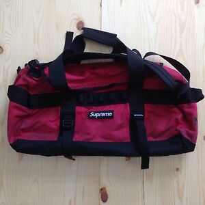 SUPREME x THE NORTH FACE WAXED  BRITISH MILLERAIN BASECAMP DUFFLE BAG TNF RED