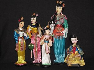 5 Vintage Chinese Dolls on Wooden Stands in Traditional Clothing $59.99