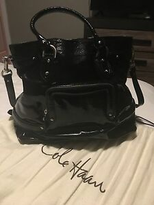 cole haan handbag large black patent leather in mint condition. Silver hardware