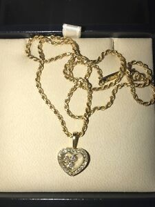 Chopard 18K gold floating diamond heart pendant necklace