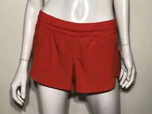 LULULEMON ORANGE RUN TRACK SIDE POCKET ZIP WOMEN'S SHORTS SIZE 6