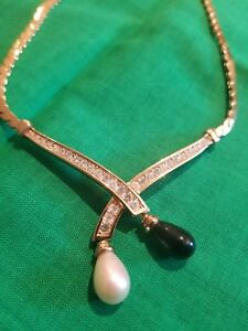 CHRISTIAN DIOR GOLD NECKLACE SET WITH CRYSTALS A PEARL DROP AND A BLACK ONYX DR