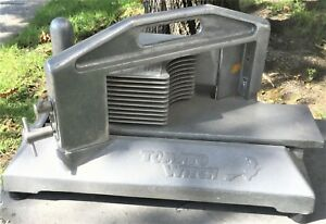 TOMATO SLICER  USED BUT IN A GREAT CONDITION WITH NO BLADES