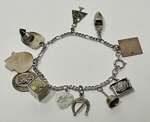 VINTAGE STERLING CHARM (11) BRACELET-Camera+Locket+Fire Helmet+$1 in Box+7 more