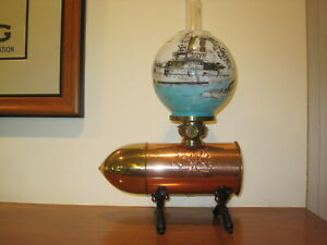 Admiral Dewey Bullet Miniature Oil Lamp with Cross Cannon Base and Painted Globe