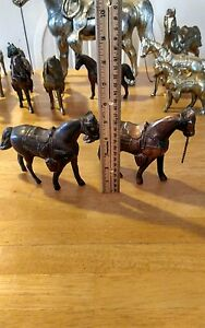 Two Vintage Metal Horses With chain for bridal. $35.00