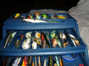 THREE TIER PLANO TACKLE BOX JAMMED FULL WITH OVER (60) SIXTY FISHING LURES
