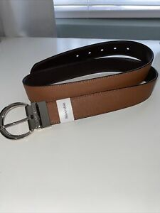 Calvin Klein Women#x27;s Reversible Leather Curved Buckle Logo Stitched Belt $25.00