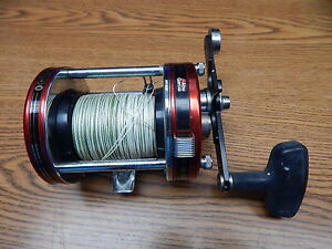 OLD ABU GARCIA 7000 BAITCASTING REEL IN RED USED BUT STILL VERY NICE WORKS GOOD