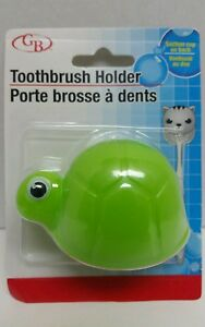 GREEN TURTLE  KIDS TOOTHBRUSH HOLDER WITH SUCTION CUP ON BACK