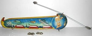 terra luna tin wind up space toy with orbiting