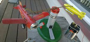 vintage handmade electric tin airplane