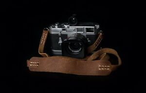 Leather camera neck strap.  Leica Fuji Film Sony and mirrorless cameras.