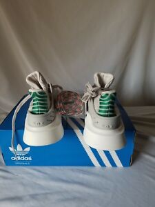 adidas Equipment adv grey sneakers with a pop of color at the heel. $80.00