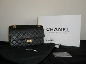 Chanel reissue 2.55 black designer handbag size 225 with gold chain