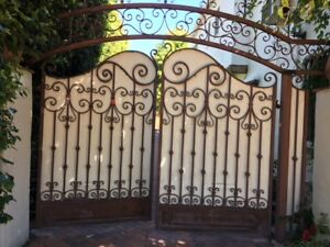 Pair of c.1920's hand forged wrought iron driveway gates