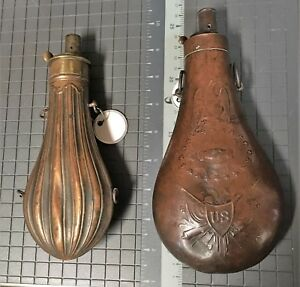 Two 1850 period powder flasks one is peace type the other is ribbed.