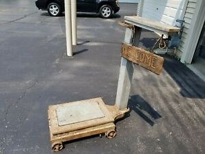 Antique scale with weights $45.00