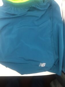 New Balance mens running shorts blue  size XL Never Worn Small Pocket In Back