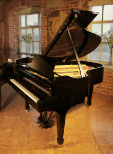 A 1936 Steinway Model M grand piano with a black case and spade legs