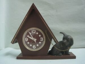 Antique desktop table clock in hard plastic and the dog are in bronze - work
