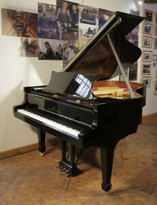 Rebuilt 1970 Steinway Model A grand piano with a walnut case and spade legs