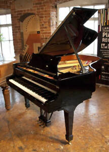 A 2003 Steinway Model A grand piano with a black case and spade legs