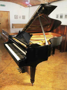 A 1974 Steinway Model B grand piano with a black case. Made in Hamburg