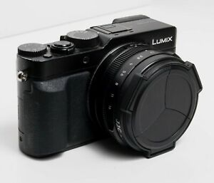 Panasonic Lumix DMCLX100 12.8MP Digital Camera - Black + 4 batteries and charger