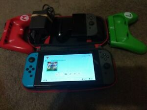 Nintendo Switch Console with Neon Red and Neon Blue Joy-Con & Extra Joycon Game