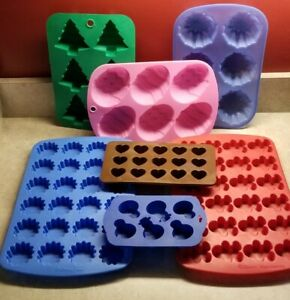 Lot of 7 Silicone Molds Wilton more Hearts Gingerbread Boy Flower Eggs Tree $15.99