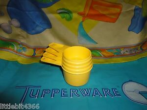 VINTAGE TUPPERWARE SET OF 4 YELLOW  MEASURING CUPS LOT # 762, 763, 764, 765