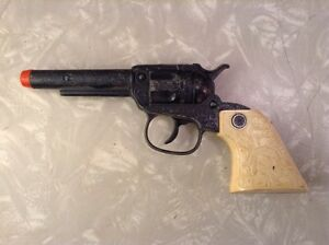 cap gun with indian profile on grips