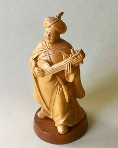 Robed Musician Wearing A Turban Playing A Stringed Instrument, India?
