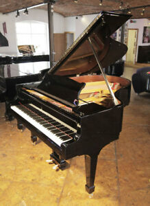 Rebuilt 1923 Steinway Model O grand piano with a black case and spade legs