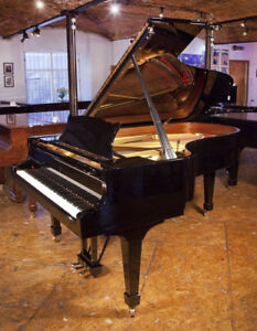 A  2013 Steinway Model B grand piano with a black case and spade legs