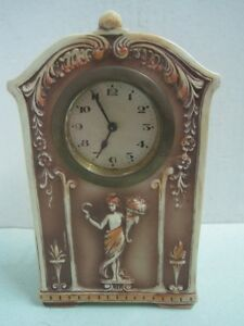 Antique desktop table clock in porcelain with a lady type Empire nº 8630